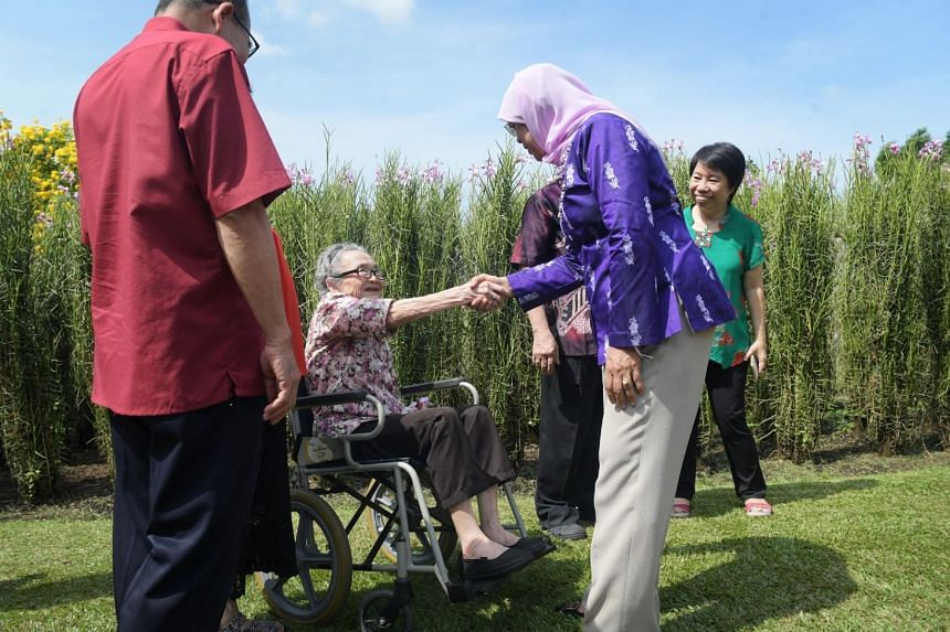 Madam Ho Kou Eng, 87, with President Halimah Yacob during a visit to the Istana orchid garden on Feb 28, 2018.