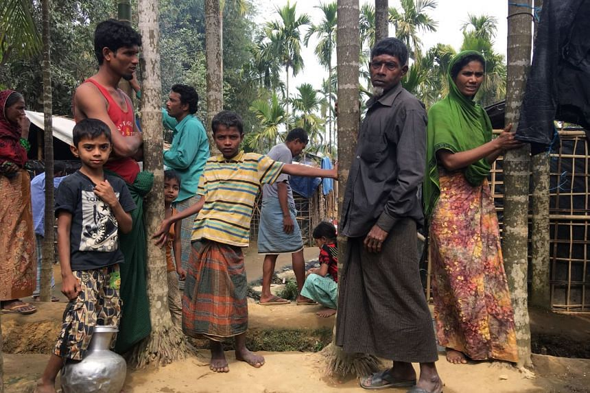 Rohingya Muslims gather outside their makeshift homes near Kutapalong refugee camp in the Cox's Bazar district of Bangladesh on Feb 9, 2018.