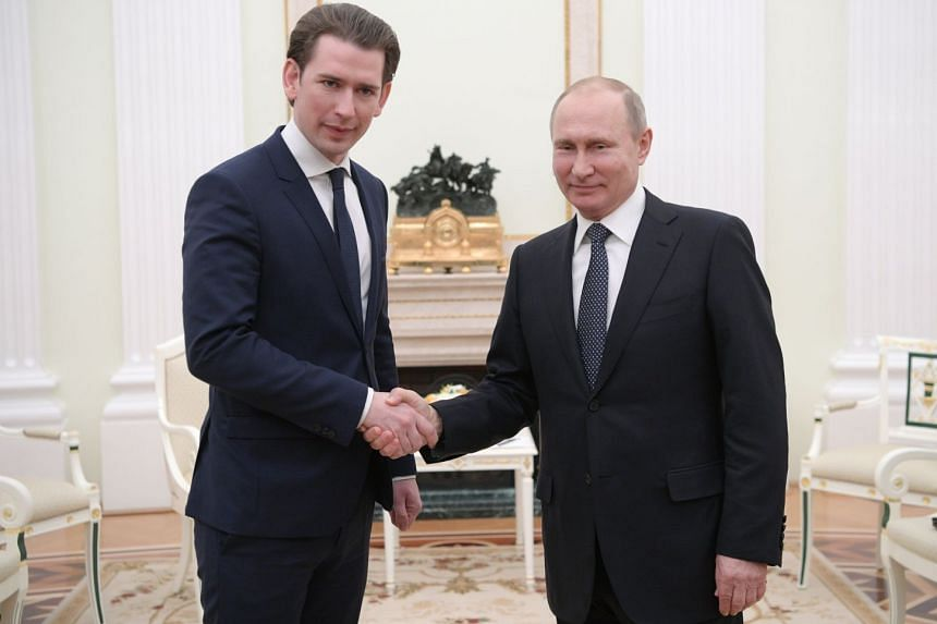 Russian President Vladimir Putin (right) shakes hands with Austrian Chancellor Sebastian Kurz during their meeting at the Kremlin in Moscow, Russia, on Feb 28, 2018.