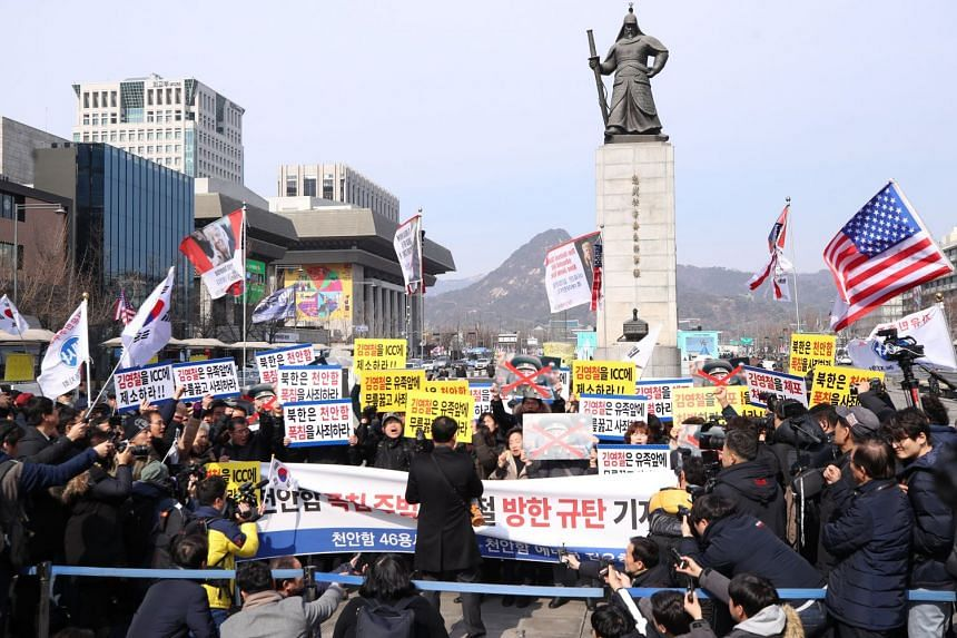 Protesters, including the families of the crewmen killed in the 2010 sinking of the Cheonan warship, stage a rally in Seoul to oppose the planned visit to South Korea by a vice-chairman of the Central Committee of the North's ruling Workers' Party, o