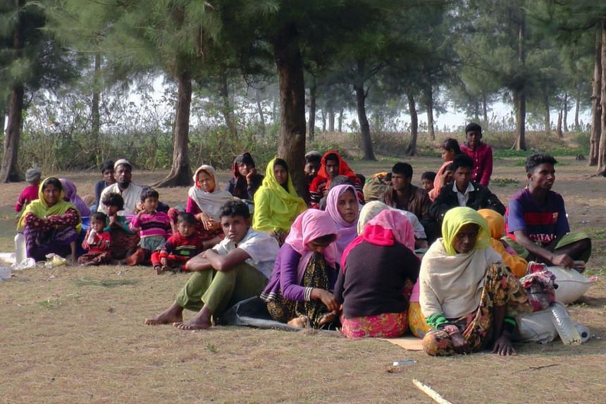 Newly arrived Rohingya refugees resting on the roadside in Teknaf after fleeing to Bangladesh from Myanmar.