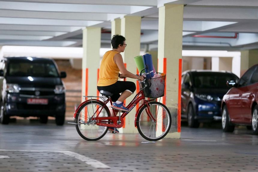 A woman cycling in a multi-storey carpark in Chua Chu Kang Street 64 on Dec 8, 2016.