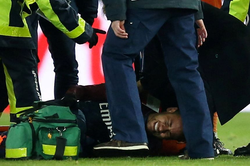 Neymar receives treatment from medical staff after sustaining an injury.