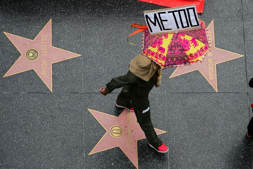 A demonstrator takes part in a #MeToo protest march in Hollywood, in November 2017.