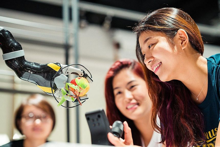 Computing students at NUS learning how technologies can improve daily living. The university will take in about 900 freshmen across six computing courses for the new academic year, up from the current 732.