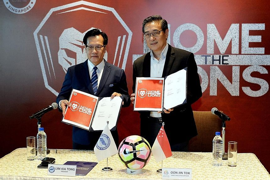 Football Association of Singapore president Lim Kia Tong (far left) and Singapore Sports Hub CEO Oon Jin Teik at yesterday's MOU signing ceremony. National footballers will get to train and play more often on the National Stadium pitch.