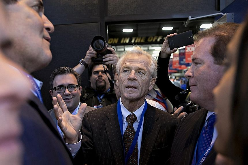 The resurgence in the Trump White House of Mr Peter Navarro (centre), seen ahead of a presidential debate in New York in 2016, indicates that trade and manufacturing policy is heating up this year.