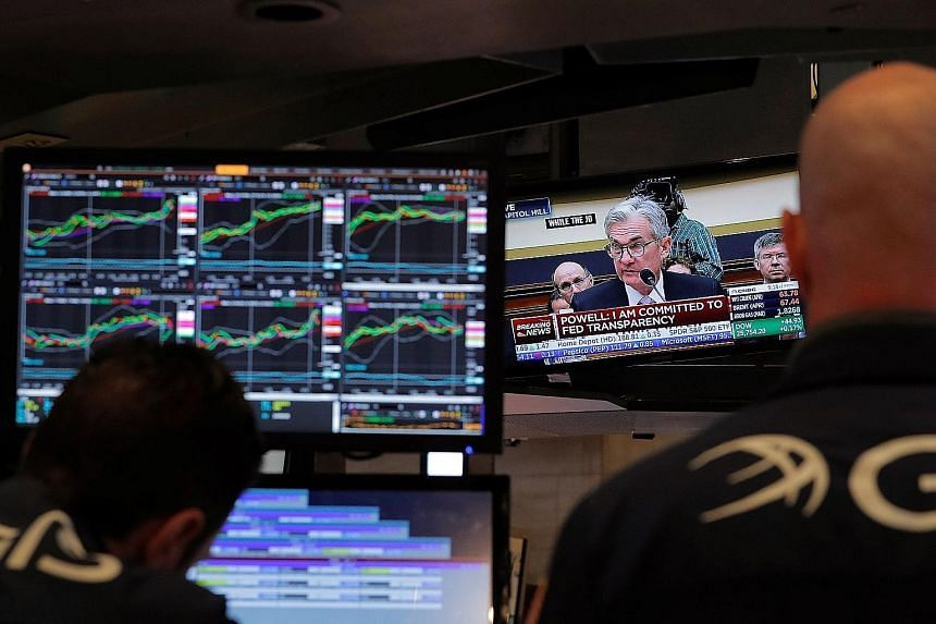 New York Stock Exchange traders watching a TV broadcast of Federal Reserve chairman Jerome Powell testifying before the US House of Representatives' Financial Services Committee on Tuesday.