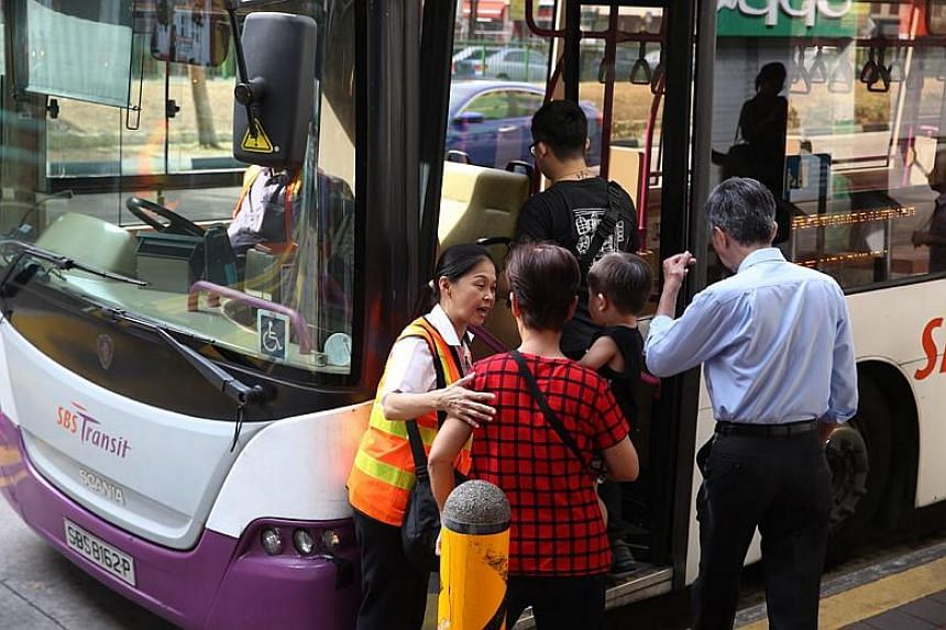 An SBS Transit staff guiding commuters outside Chinatown MRT station on March 1, 2018.