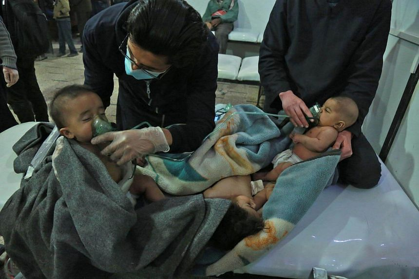 Syrian babies receive treatment for a suspected chemical attack at a makeshift clinic on the rebel-held village of al-Shifuniyah in the Eastern Ghouta region, on Feb 25, 2018.