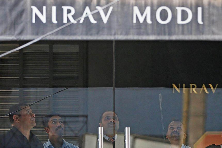 Security guards inside a Nirav Modi showroom during a raid in New Delhi, India, on Feb 15, 2018.