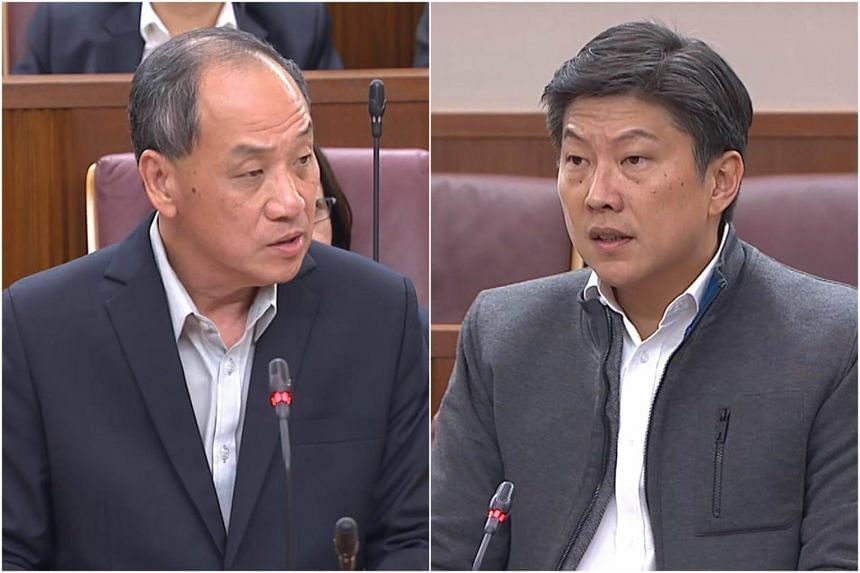 Workers' Party chief Low Thia Khiang (left) had an exchange with Education Minister (Schools) Ng Chee Meng on the GST hike on Feb 28, 2018.