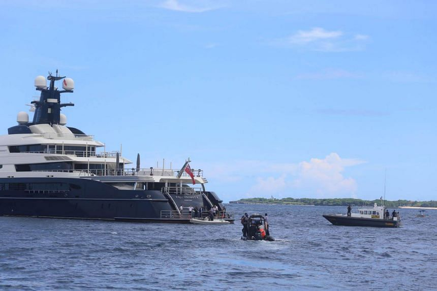 Indonesian officials preparing to board the luxury yacht allegedly owned by Malaysian businessman Jho Low.
