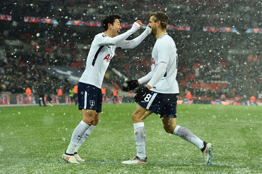 Llorente celebrates with Tottenham Hotspur's South Korean striker Son Heung-Min scoring the team's fourth goal.