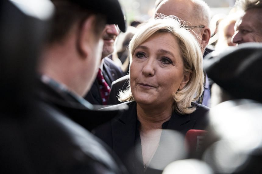 French far-right leader Marine Le Pen visits the Paris International Agricultural Show in Paris on Feb 28, 2018.