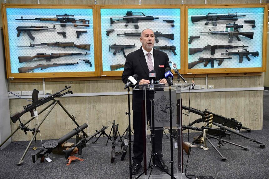 Detective Chief Inspector Wayne Hoffman of the New South Wales Police speaking to the media with guns previously seized from criminals displayed behind him on Aug 8, 2017.