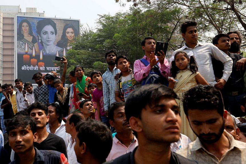 Fans of Bollywood actress Sridevi waiting to pay their last respects outside a makeshift memorial in the Indian city of Mumbai yesterday. The legendary actress drowned in the bathtub after losing consciousness late last Saturday in a hotel in Dubai,