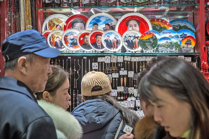 Souvenirs of President Xi Jinping and former leader Mao Zedong in a Beijing shop. The third plenum, usually held in autumn, was brought forward to this month to discuss state leadership.
