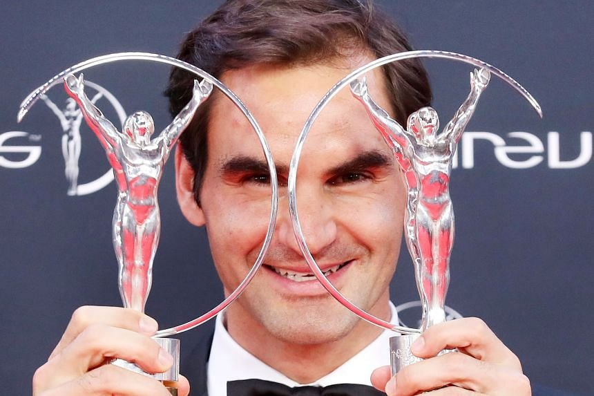 Roger Federer with the trophies for Comeback of the Year and Sportsman of the Year at the Laureus World Sports Awards in Monaco on Tuesday. He said confidence and momentum are prime factors in unlocking a player's potential to win Grand Slams.