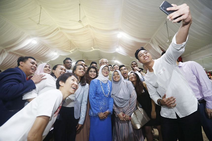 President Halimah Yacob and Minister for Culture, Community and Youth Grace Fu taking a wefie with a group of athletes during a dinner reception at the Istana last night.