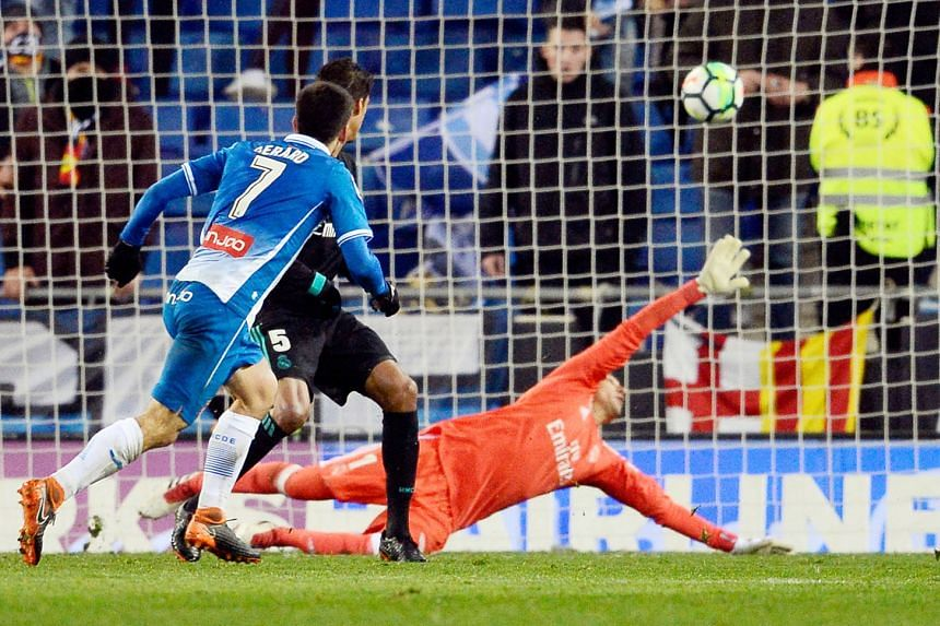 Espanyol forward Gerard Moreno scoring the game's only goal past Real goalkeeper Keylor Navas and defender Raphael Varane deep in stoppage time on Tuesday. It was Real's fifth LaLiga loss this season.