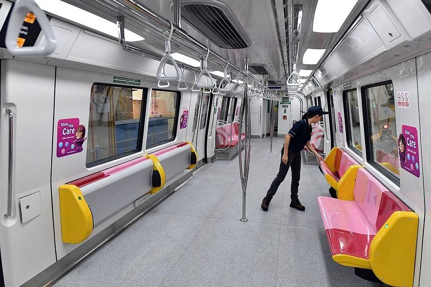 The Land Transport Authority unveiled trains that can pack in 100 more commuters each, through the use of tip-up seats.