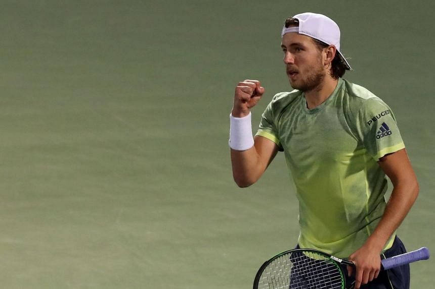 Pouille reacts after during his match against Karen Khachanov of Russia.