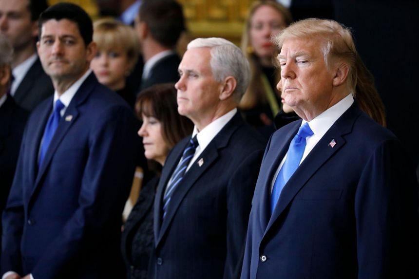 Paying tribute are (from left) House speaker Paul Ryan, Karen Pence, US Vice-President Mike Pence and President Donald Trump.