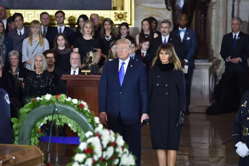 Donald and Melania Trump pay their respects at the Rev. Billy Graham's casket.