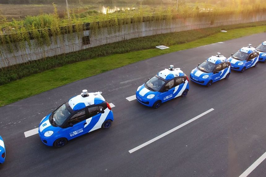 Vehicles equipped with Baidu's autonomous driving technologies conduct road testing in Wuzhen, China, in July 2017.