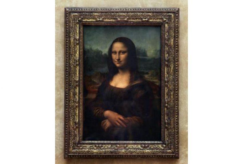 Mona Lisa, painted by Leonardo da Vinci, in the Louvre Museum in Paris on April 5, 2005.