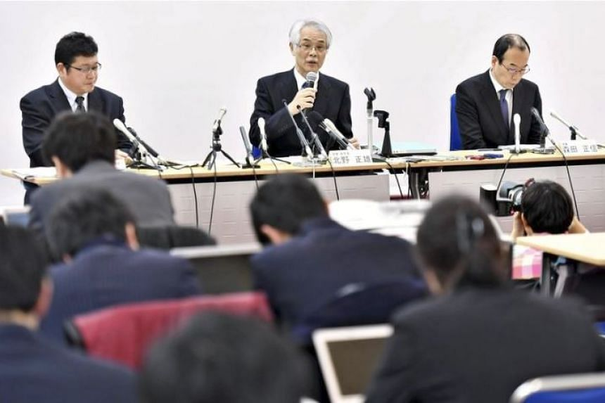 Kyoto University executive vice-president Masao Kitano (centre) explains the mistakes found in the university's entrance exam at a press conference on Feb 1, 2018.