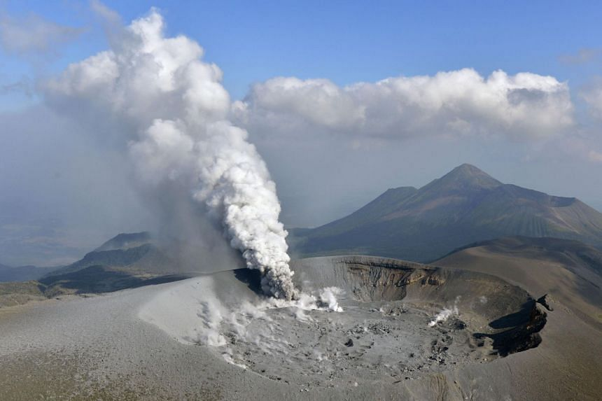 This file photo shows Mount Shinmoe, which straddles Japan's Kagoshima and Miyazaki prefectures, after a small-scale eruption on Oct 11, 2017.