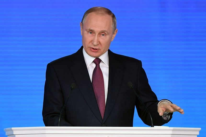 Russian President Vladimir Putin addresses the Federal Assembly at Moscow's Manezh exhibition centre on March 1, 2018.