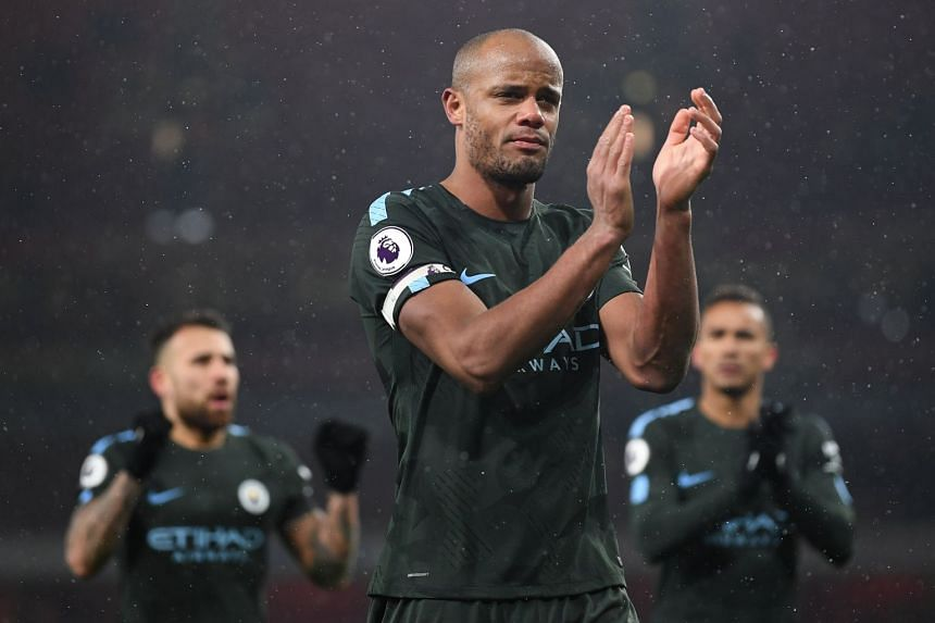 City's Vincent Kompany reacts following the team's win.
