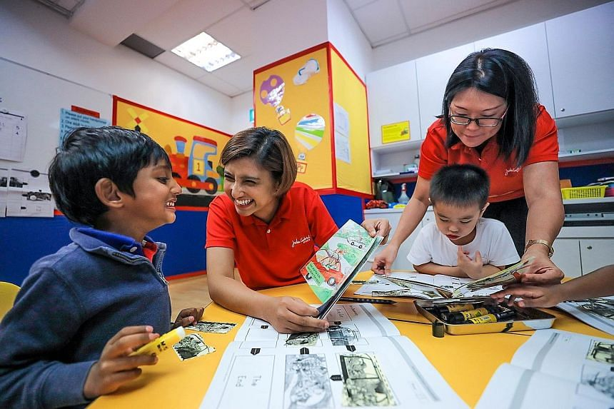 Kindergarten 1 children Raghav Swaminathan and Brandon Foo Fang Wei enjoying reading with teachers Naziahaseen Mohamed Nazir (seated) and Audrey Chew during a weekly reading programme at the Julia Gabriel Centre at The Forum last week. Pupils in Sing