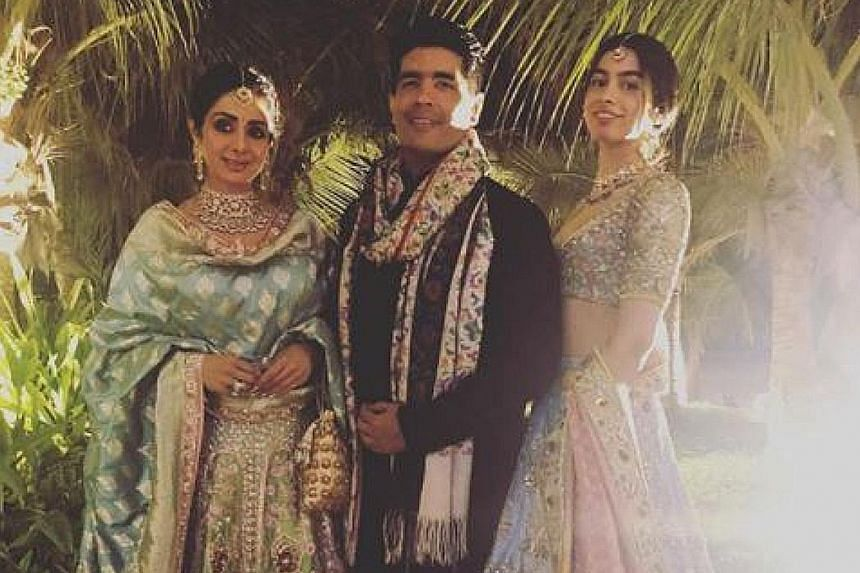 """Fashion designer Manish Malhotra shared this photo of himself with Sridevi (left), taken with her daughter Khushi Kapoor, on Instagram on Monday with the caption: """"This was our last picture together and just 4 days ago... I will never be able to get"""