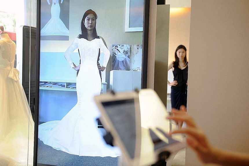 At La Belle Couture, women can try on 20 gowns in a minute using FX Mirror, an augmented reality system involving 3D visualisation.