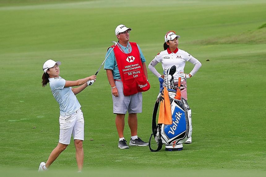 With seven birdies and a seven-under 65 on the opening day of the HSBC Women's World Championship, Jennifer Song (far left) has a two-shot lead against all expectations. The American has missed 61 cuts in 155 starts. Playing partner Lee Mi Hyang card