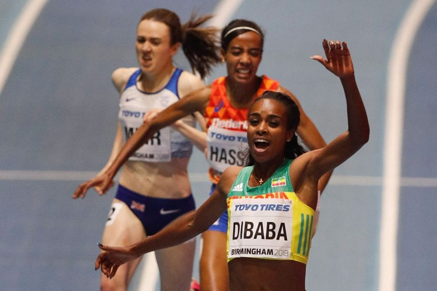 Dibaba finishes ahead of the Netherlands' Sifan Hassan (centre) and Britain's Laura Muir.
