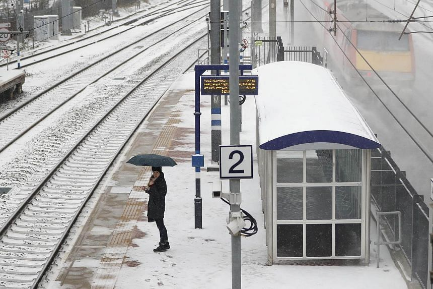 A woman waits at a train station in north London on March 1, 2018.