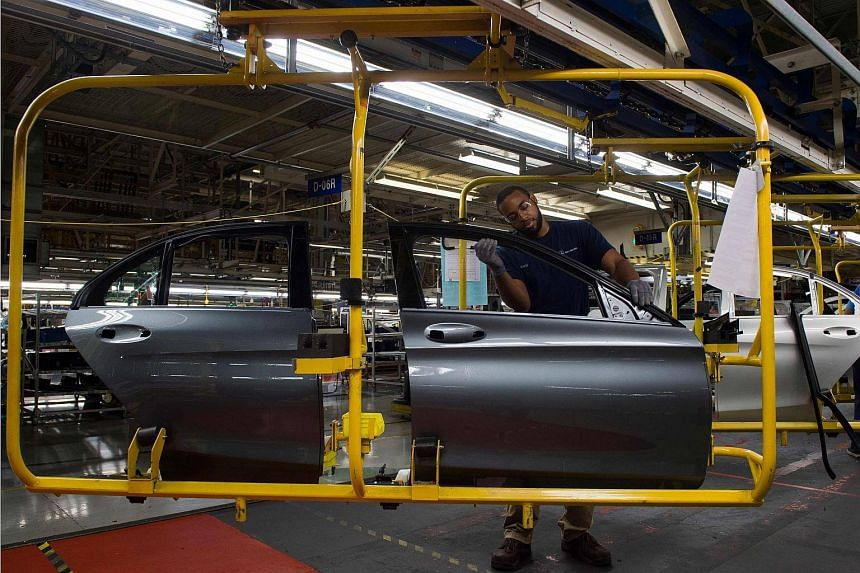 An employee works on the doors for a Mercedes-Benz C-Class at the Mercedes-Benz US International factory in Vance, Alabama, on June 8, 2018.