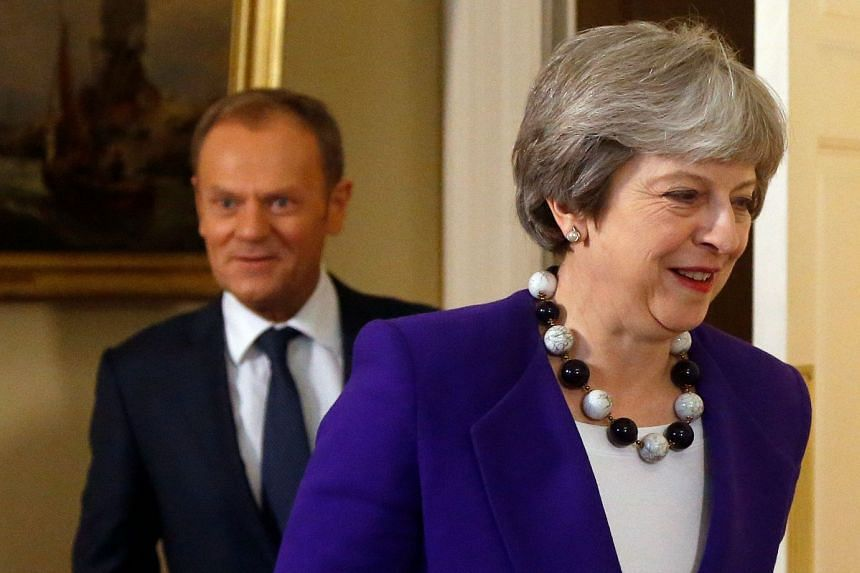 Tusk (left) following May into their meeting at 10 Downing street in central London on March 1, 2018.