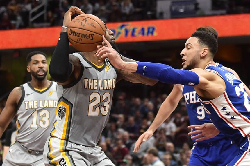 Philadelphia 76ers guard Ben Simmons (right) knocks the ball from Cleveland Cavaliers forward LeBron James during the second half at Quicken Loans Arena in Cleveland on March 1, 2018.