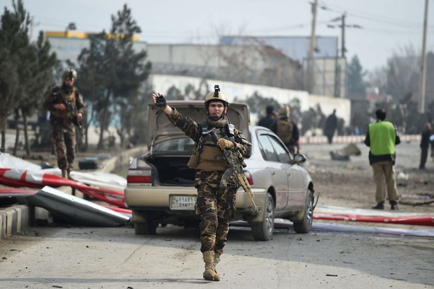 Afghan security personnel at the site of a car bomb attack in Kabul on March 2, 2018.