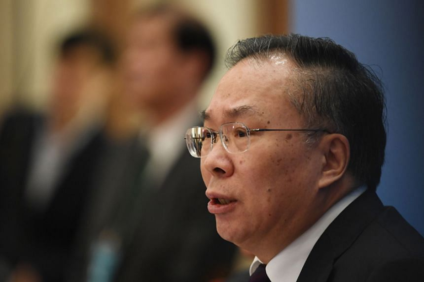 Wang Guoqing, spokesman for the Chinese People's Political Consultative Conference, speaks at a press conference a day before the opening session of the advisory body in Beijing on March 2, 2018.