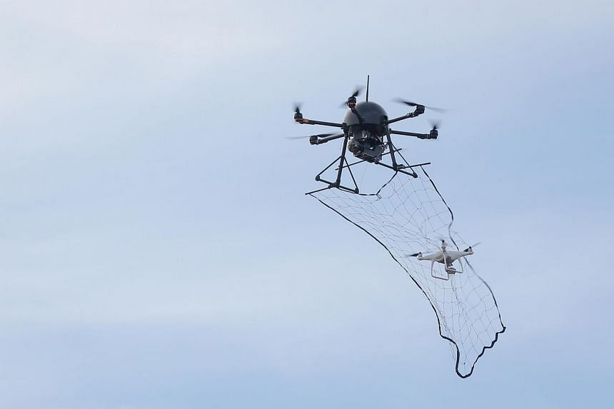 """A counter-drone system that uses a """"drone-catcher"""" to take down errant drones."""