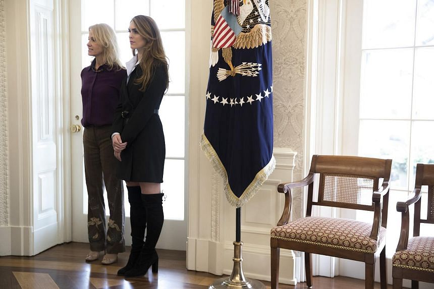 Hope Hicks (right) the White House communications director, stands beside Kellyanne Conway, a counsellor to the president, in the Oval Office of the White House in Washington on Feb 9, 2018.