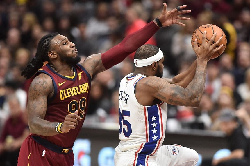 Philadelphia 76ers forward Trevor Booker drives to the basket against Cleveland Cavaliers forward Jae Crowder during the second half at Quicken Loans Arena.