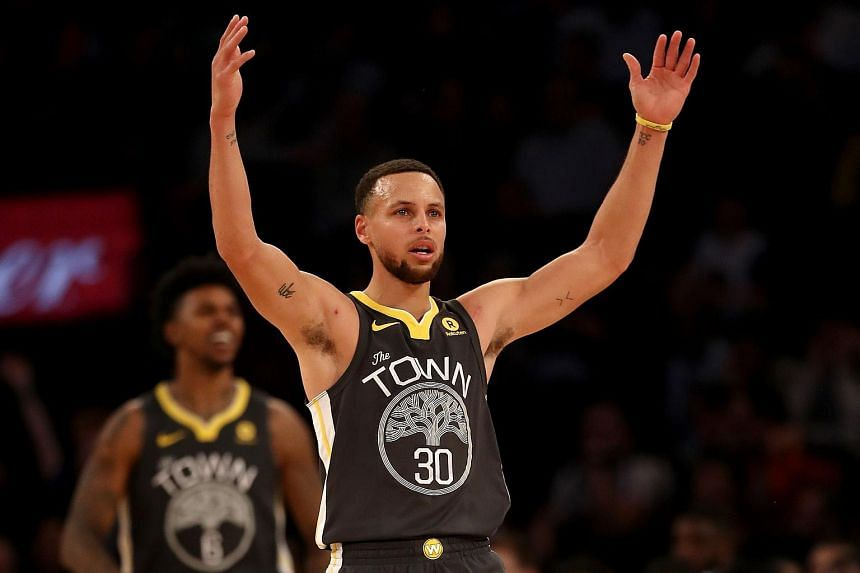 Stephen Curry of the Golden State Warriors celebrates his three point shot in the second half against the New York Knicks at Madison Square Garden on Feb 26, 2018.
